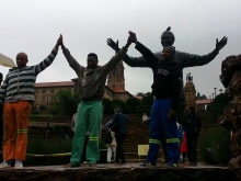 Nelson Mandela's legacy is everywhere. You can see his statue behind these young men who were posing for a photo.